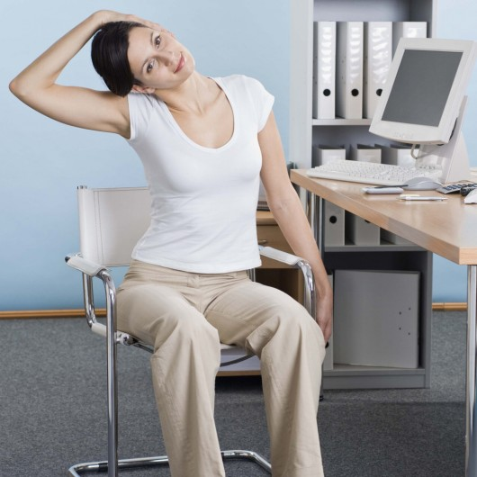 Girl Stretching in the Office