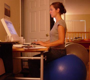 Girl Sitting on Fitness Ball