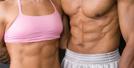 A fir couple showing strong abs. A couple with six pack.