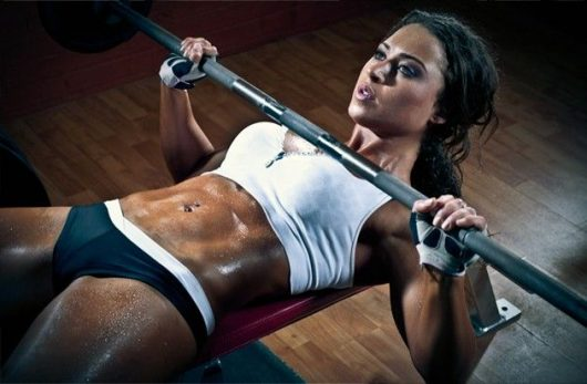 Woman Doing Bench Press