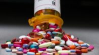 a pile of colourful pills is falling out of pill bottle