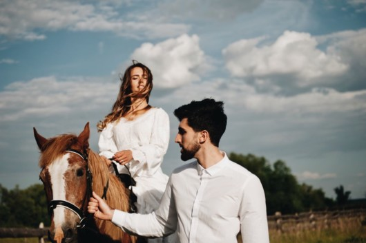 Man and woman are taking a horse ride as their first date