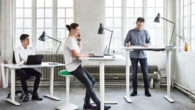 people are working at the standing desks