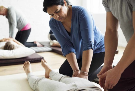 People are at the massage school practicing to get the certificate