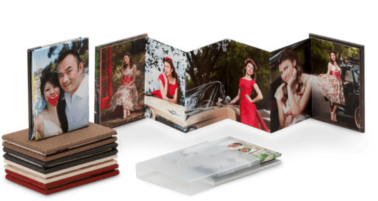 Accordion book with photos on white background