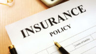 Insurance policy paper on wooden table