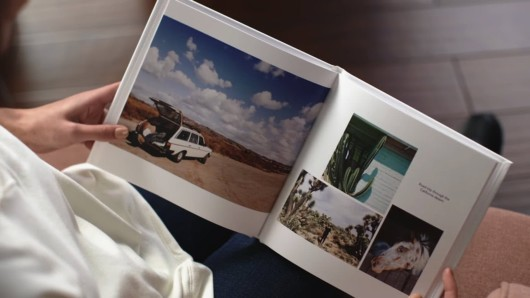 A girl checking her photo book that she made to preserve her memory