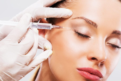 Doctor is using thin needle will be used to administer small amounts of botulinum into the skin and/or muscles