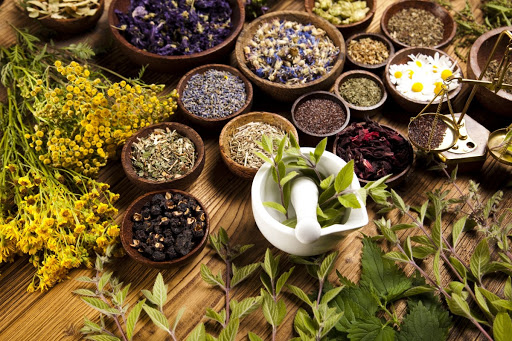 Different herbs on wooden table