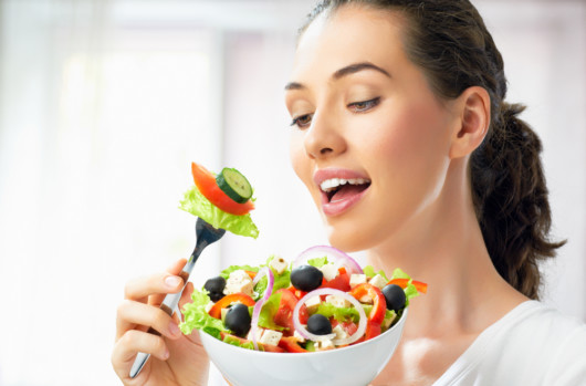 Girl with a big bowl of salad. Girl is on a diet and planing to eat the salad