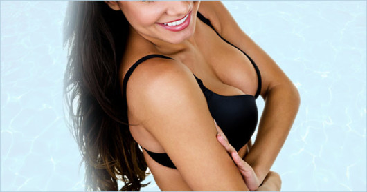 Girl in black bra is showing her beautiful breast after  Breast Lift and Augmentation