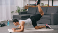 Guy is exercising at home to build muscles