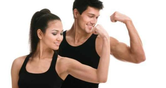 A woman and a man in black undershirt on white background are showing their biceps