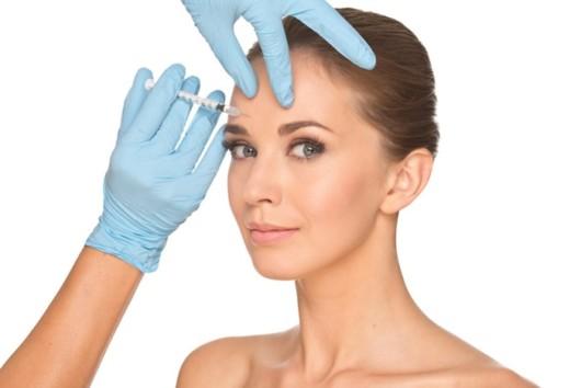 Beautiful girl is doing non-invasive treatment. The girl is doing botox