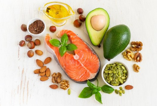 Avocado, oil, seeds, nuts, nuts and fish are on white background