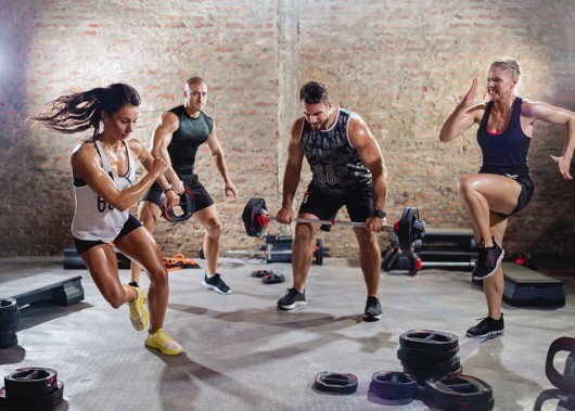 Two men and two women doing hiit workout in the gym