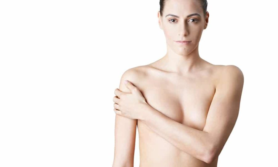 Girl covering her breasts after bilateral mastectomy