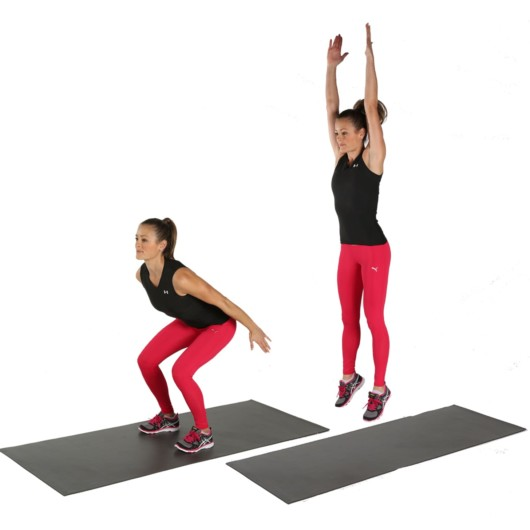 An athlete girl shows how to perform jump squat exercise