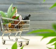 Cbd products in the cart on the wooden background