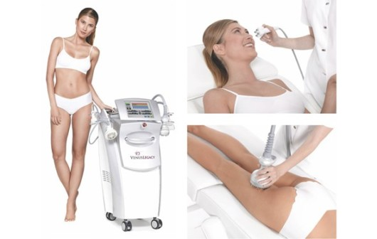 A beautiful girl on the white background is standing next to Venus Legacy device. She is treating her face and legs with Venus Legacy Treatment.