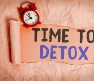"The words ""time to detox"" are written on the pinky paper"