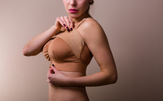 Girl wearing a post operation bra after breast augmentation