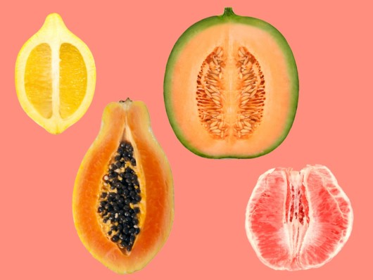 Fruits like lemon, watermelon, papaya and grapefruit on the pinky background