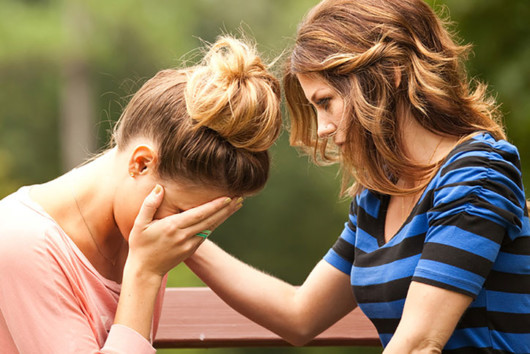 A girl is helping her friend to cope with a grief from the loss