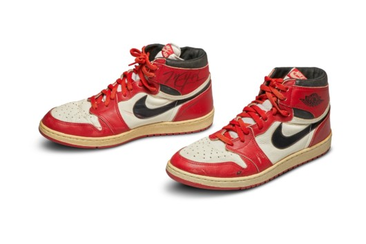 A photo of red and white Air Jordan 1 sneakers on white background