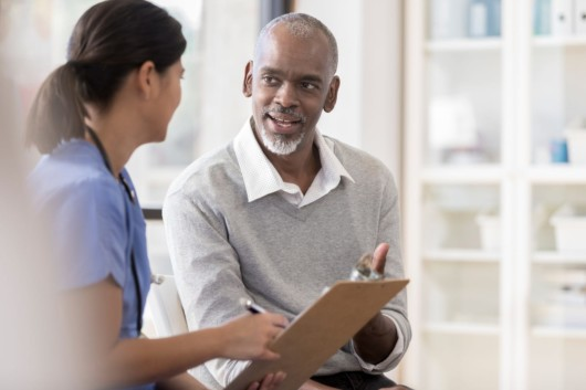 A man is asking questions about the hospice