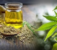 CBD oil, hemp seeds and hemp leaves on the wooden background
