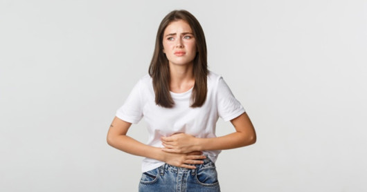 Girl is writhing with gastric pain. She has heartburn
