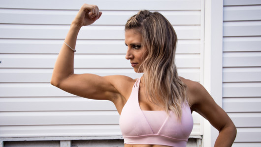 Beautiful girl is showing her bicep