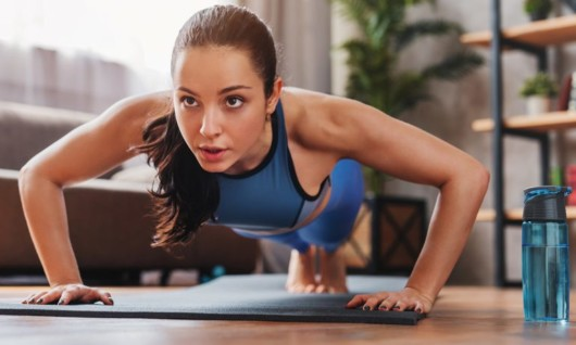 Girl is doing push ups at home