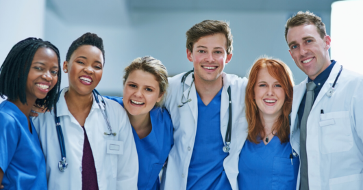A group of healthcare professionals are smiling