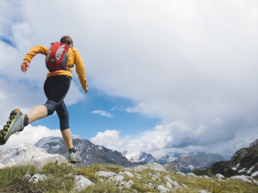 Girl is running in the mountains