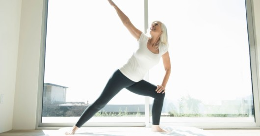 Woman is doing yoga in the room