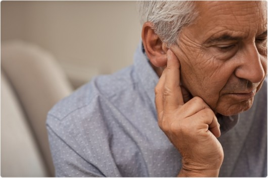 An old man with a hearing loss