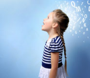 a little girl in a blue stripped dress is standing with her mouth open on the blue background with white letters behind her