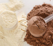 White and chocolate protein powder in a measure spoons