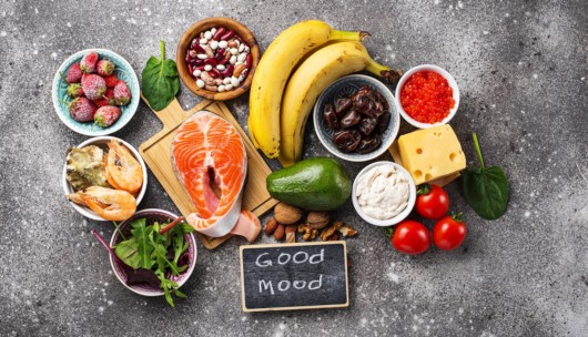 healthy vegetables and fruits that help to fight MDD on the grey background